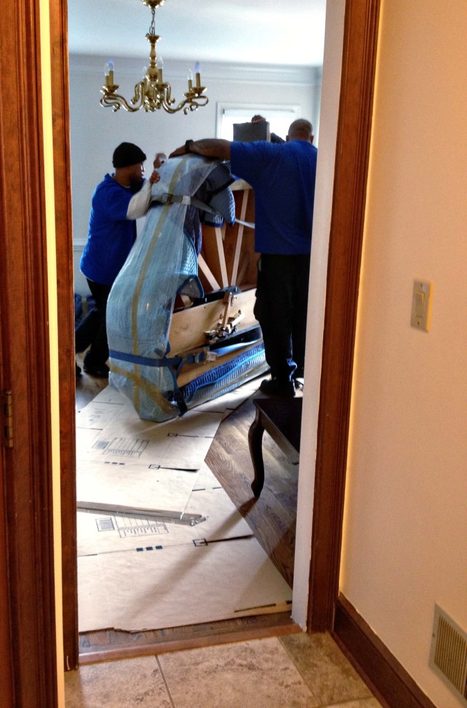 Moving the piano in.