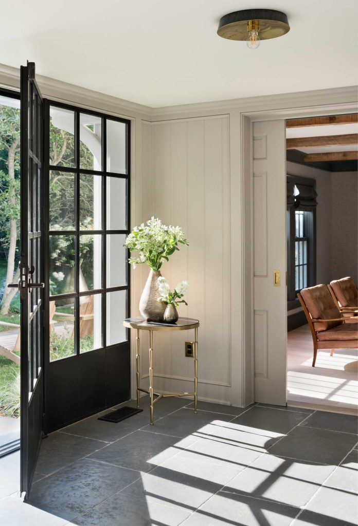 renovated farmhouse black door via remodelista