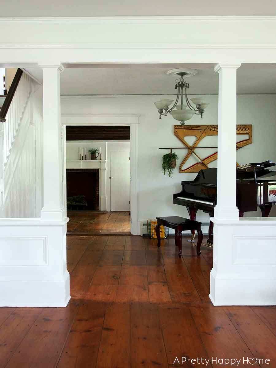music room with piano and piano harp art