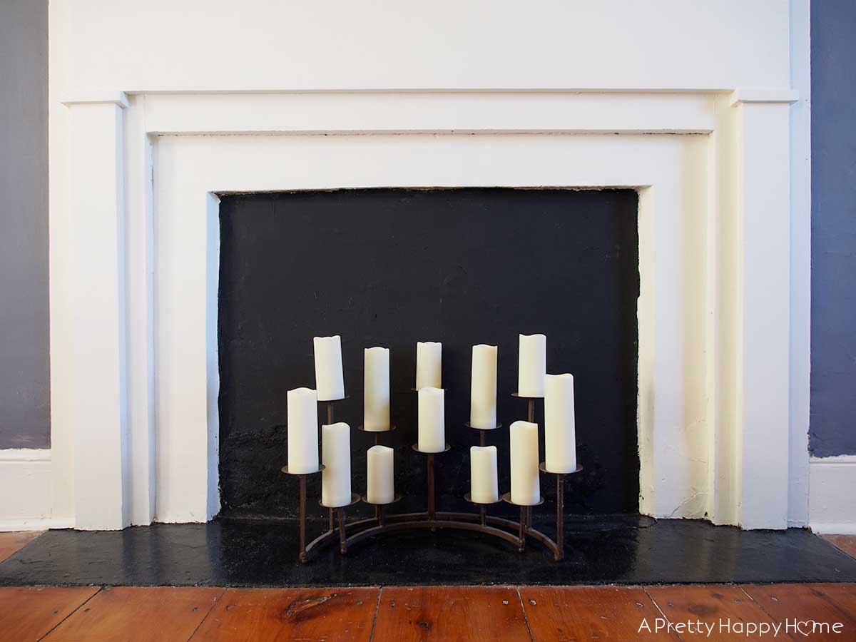 LED candles brighten up a non-working bedroom fireplace.