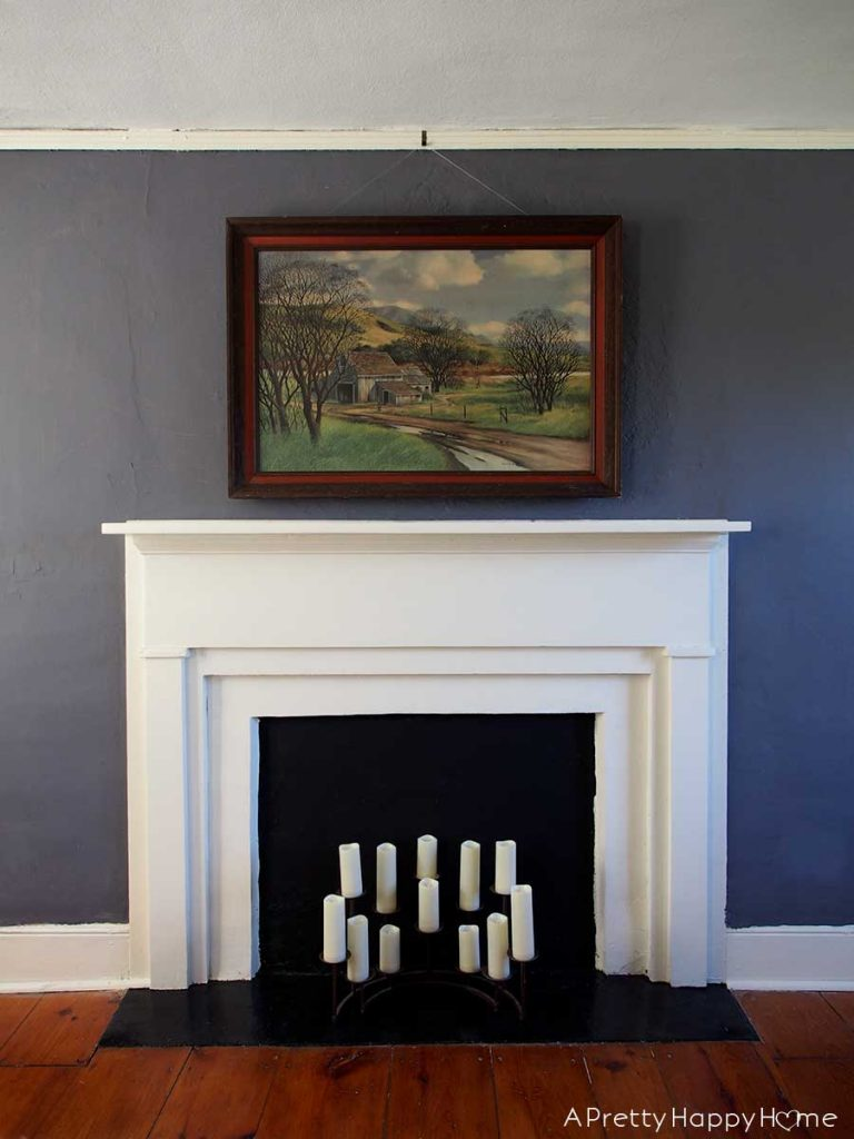 james peter cost painting over white fireplace