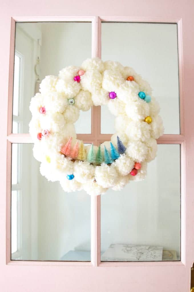 bottle brush pom pom wreath from modern glam home on the happy list
