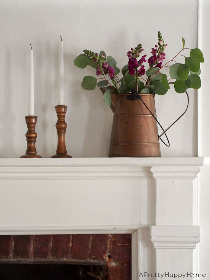spring flowers on a colonial farmhouse mantle on the happy list