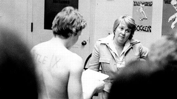 March 3, 1976: Joni Barnett, Yale's Director of Physical Education, listens as Chris Ernst reads the team's grievance. Nina Haight/Yale Daily News