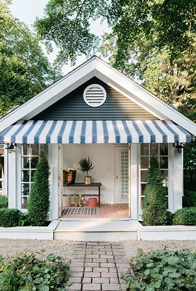 Photographed by Margaret Rajic for Kate Marker Interiors guest house with blue and white awning via lonny on the happy list