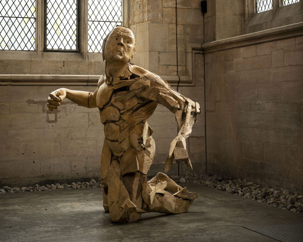 British sculptor Jamie Frost wood sculpture via creative boom on the happy list