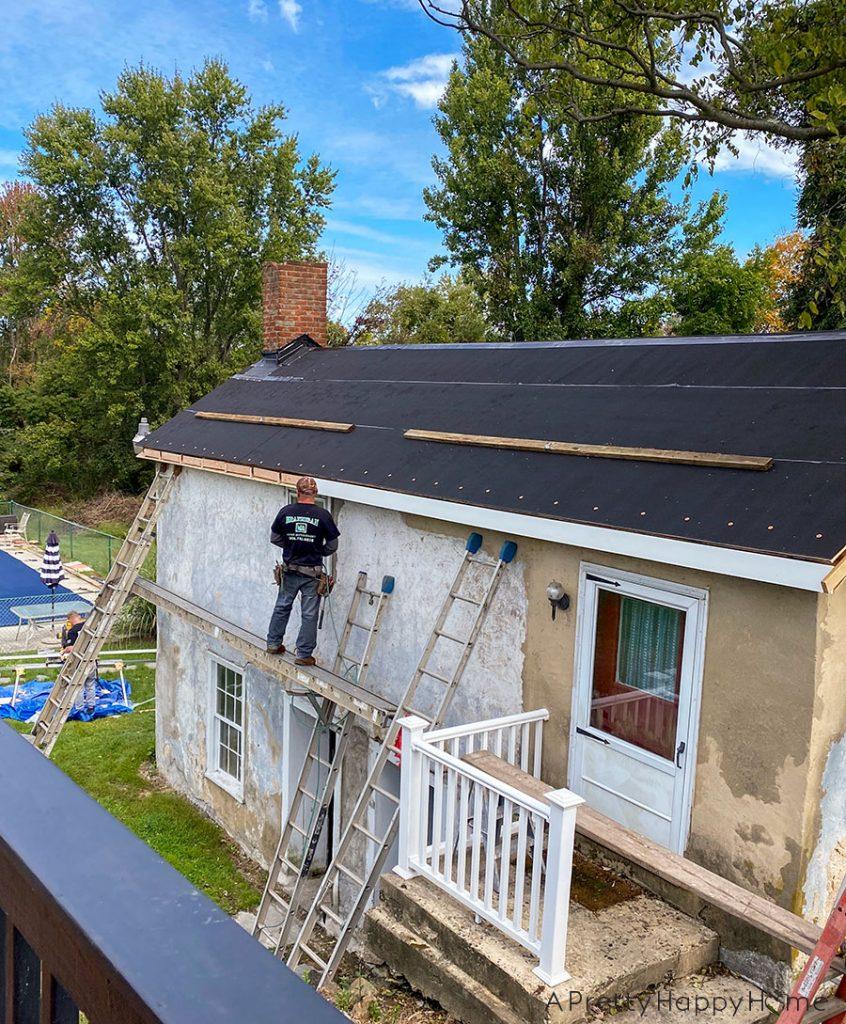 black metal roof carriage house new fascia