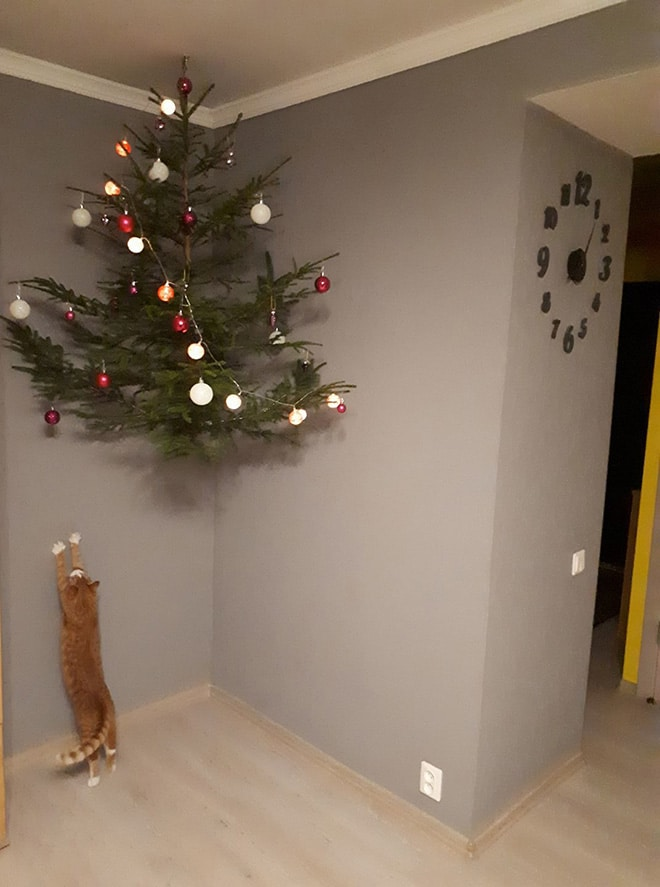Christmas tree protected from pets via sad and useless on the happy list