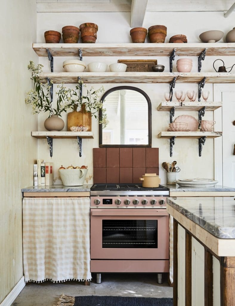 PHOTOGRAPHY BY NICOLE FRANZEN; STYLING BY KATE BERRY leanne ford pink kitchen via domino on the happy list