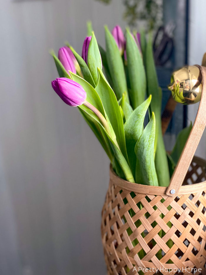 purple tulips in basket on the happy list