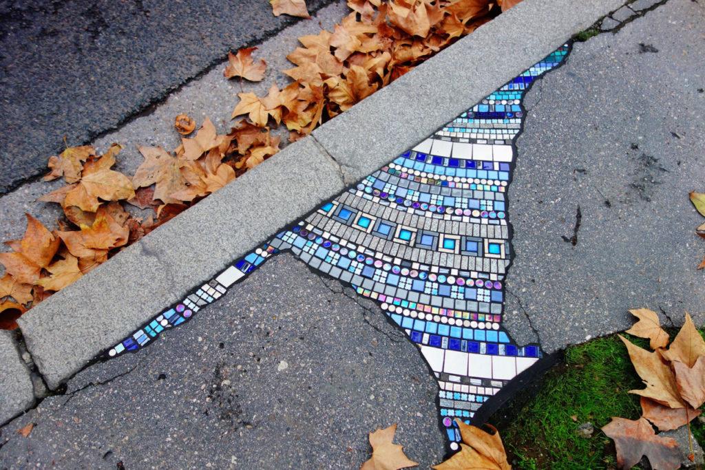 cracked sidewalk mosaic repair copyright ememem via this is colossal on the happy list