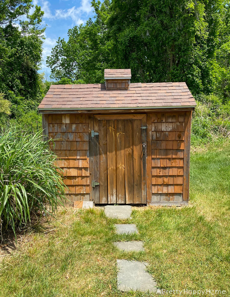 shed makeover with black stain before