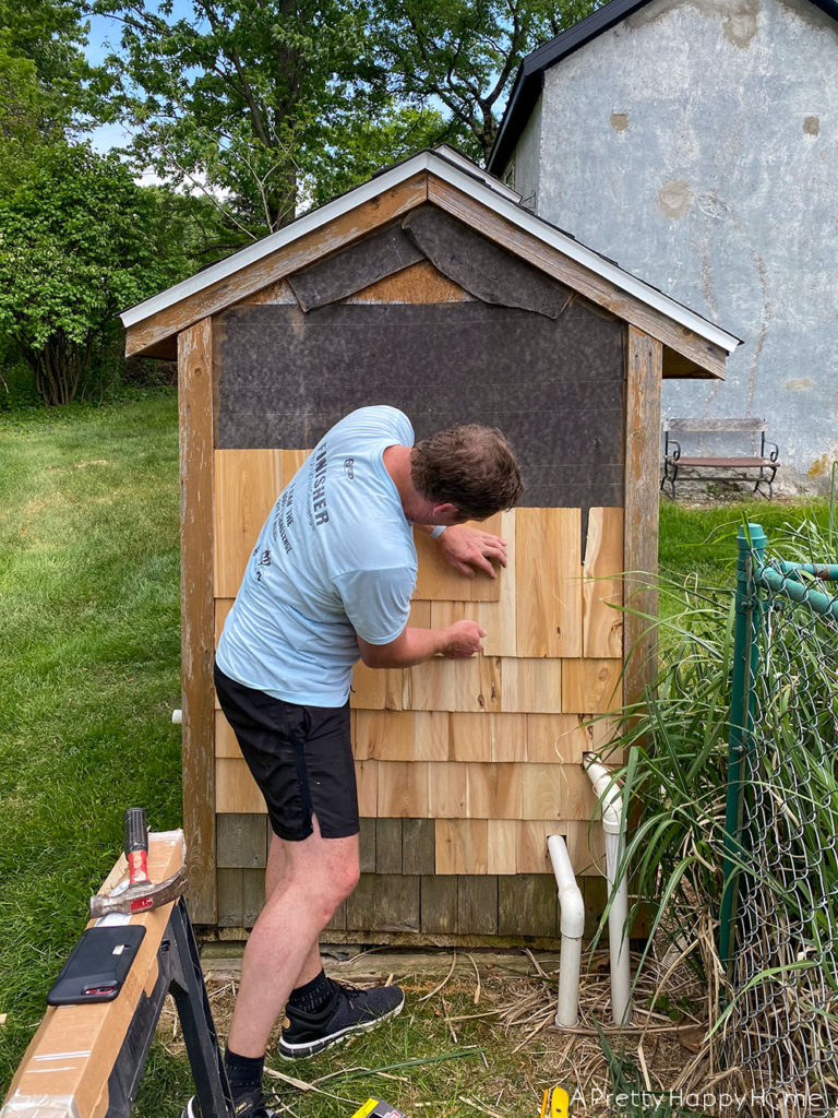 shed makeover with black stain during