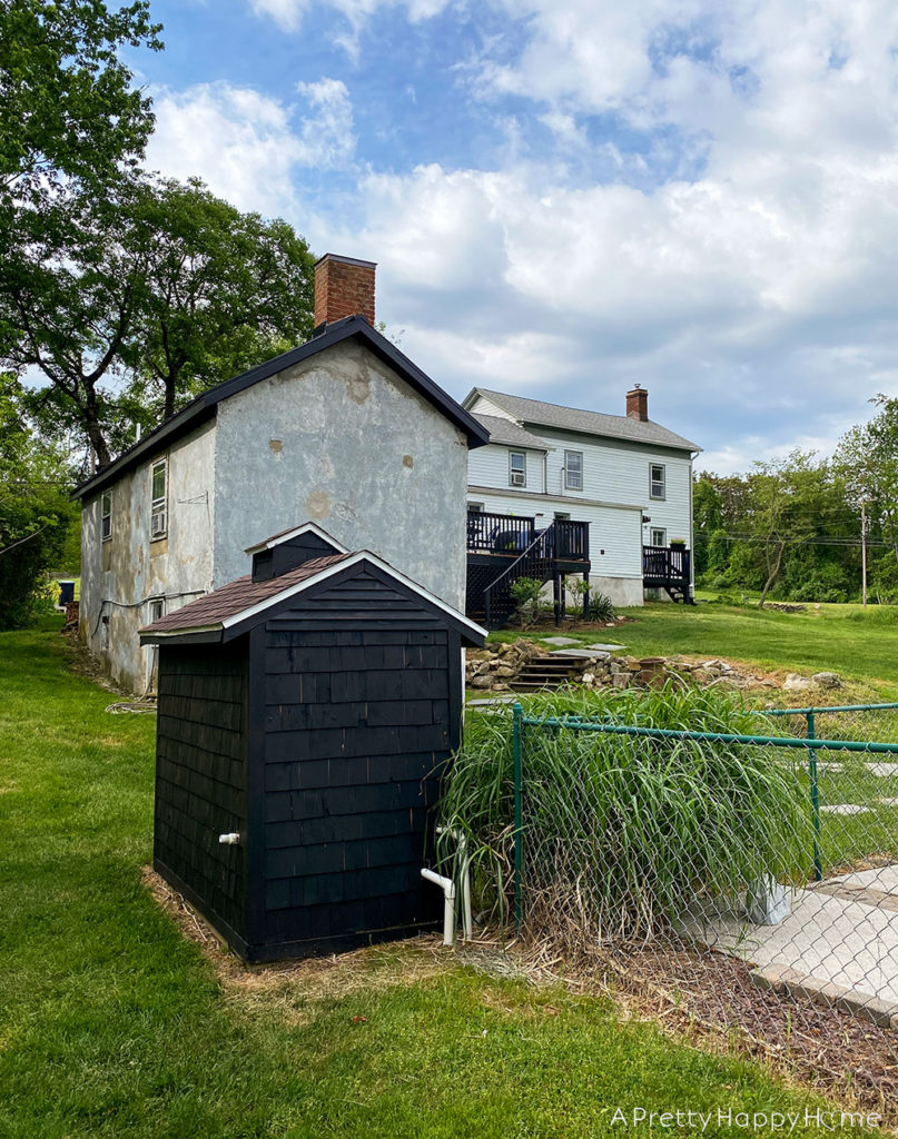 shed makeover with black stain
