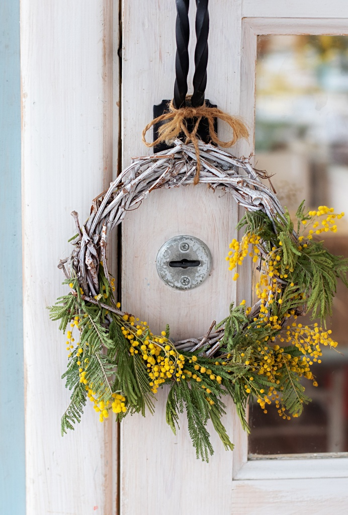 yellow berry summer wreath via town and country living on the happy list