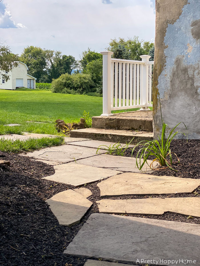 colonial farmhouse landscaping stone path outdoor project progress